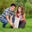 Keyboard recycling concept with couple — Stock Photo