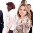 Portrait of young confident woman with her staff — Stockfoto #27438439
