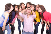 Man going nuts with eight women kissing him — 图库照片