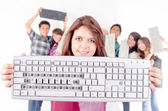Friends recycling keyboards with the word recicla — Stock Photo