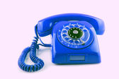 Old BLue telephone with rotary dial — Stock Photo