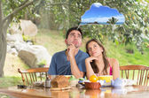 Smiling beautiful couple dreaming about vacations — Stock Photo