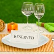 Reserved sign in dinner plate — Stock Photo