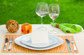 Empty classic white plate in a restaurant with blank card and copyspace for example guest names. — Stock Photo