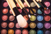 Colorful eye shadows palette with professional make-up brush. — Stock Photo