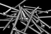 Screws on Black background — Stock Photo