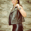 A young and beautiful latina gang woman in leather — Foto Stock