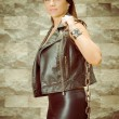A young and beautiful latina gang woman in leather — Stock Photo
