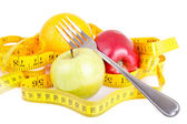 Diet concept. Fruits with measuring tape — Stock Photo