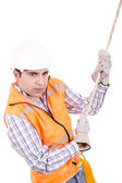 Adult man wearing safety equipment descending a rope — Stock Photo
