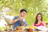 Happy, attractive couple eats breakfast together — Stock Photo