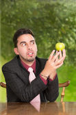 Modern businessman with apple — Stock Photo