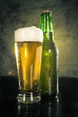 Close up of beer bottle and glass — Stock Photo