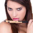 Attractive woman holding chopsticks — Stock Photo #30524635