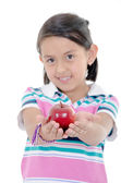 Adorable little girl eating an apple solated against white background — Stock Photo