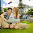Couple of tourists in old town Quito Ecuador main plaza — Stock Photo