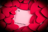Calendar page with red hearts highlight on February 14 — Foto de Stock