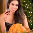 Woman showing to the camera Christmas turkey for dinner — Stock Photo
