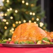 Garnished roasted turkey on holiday with red wine — Stock Photo