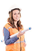 Female construction worker reading blue prints — Stock Photo