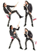 Caucasian man playing broom like guitar against white background. — Stock Photo