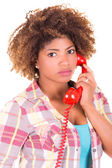 Portrait of a pretty black young woman talking on phone — Stock Photo