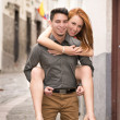 Stock Photo: Young couple, candid shot. They are walking in the streets of Quito, Ecuador