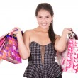 Beautiful hispanic woman with a lot of shopping bags — Stock Photo