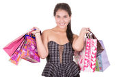 Beautiful hispanic woman with a lot of shopping bags — Zdjęcie stockowe