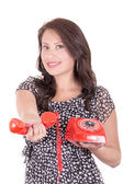 Portrait of young woman talking on vintage telephone against a abstract background — Stock Photo