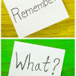 Remember and what written on two sticky notes — Stock Photo