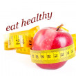 Dieting concept  apple with measuring tape — Stock Photo