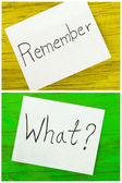 Remember and what written on two sticky notes — Foto de Stock