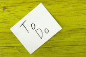 To do written on sticky note — Stockfoto