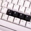 Word Easy written with black keys on computer keyboard. — Stock Photo