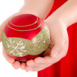 Child Hand holding a christmass ornament — Stock Photo