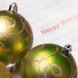 Green Christmas tree balls with happy holiday — Stock Photo #36744895