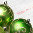 Green Christmas tree balls with happy holiday — Stock Photo #36744991