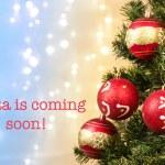 Closeup of xmas-tree decorations with Santa coming sign — Stock Photo