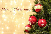 Closeup of xmas-tree decorations with merry Christmass sign — Stock Photo