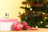 Red Christmas gift box with ornaments and tree, birds — Stock Photo