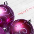 Multicolored Christmas tree balls with happy holiday — Stock Photo