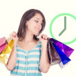 Shopping concept. woman with bags thinking about time — Stock Photo