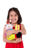 Innocent little girl playing with a doll — Stockfoto