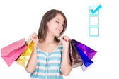 Shopping concept. woman with shopping bags thinking — Stok fotoğraf