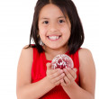 Girl holding a christmass ornament — Stock Photo