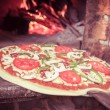 Pizzentering wood oven — Stock Photo #39595563