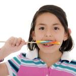Little girl holding lollipop — Stock Photo