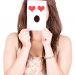 Woman showing a love emoticon in front of face — Stock Photo #40039177