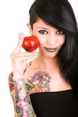 Portrait of caucasian young woman with apple and tattoos — Stockfoto